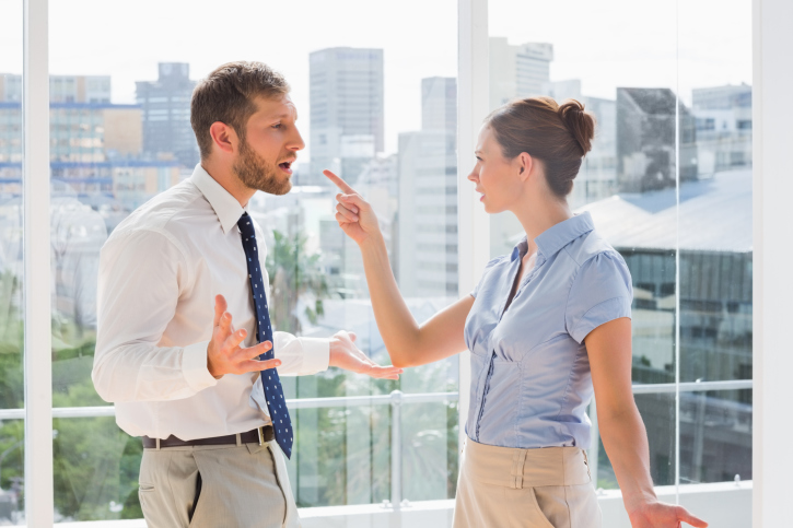 Man and woman arguing in office