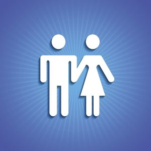 White male and female silhouette holding hands on blue background