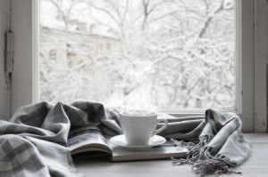 Cup and blanket on windowsill