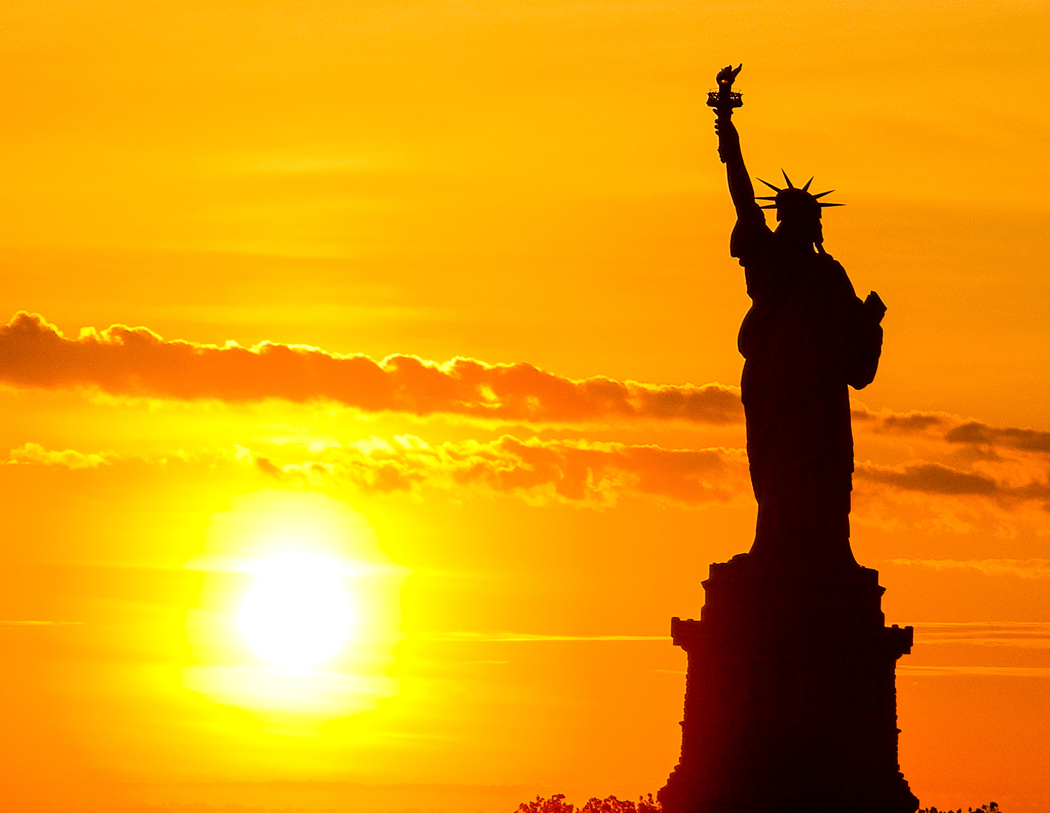 Statue of Liberty silhouette at sunset