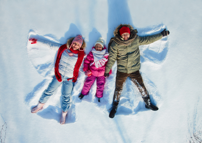 Family making snow angels