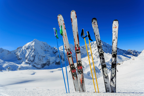 Skis and ski poles standing up in snow