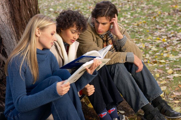 Three college students studying outside