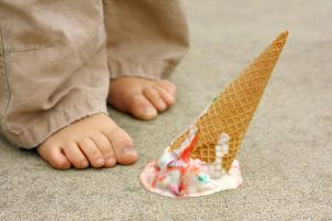 fallen ice cream cone by feet