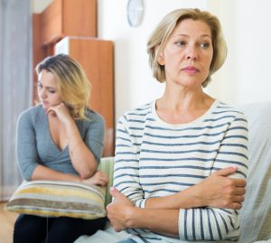Disagreement between middle-aged woman and adult daughter