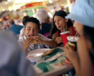 Kids eating unhealthy food at restaurant
