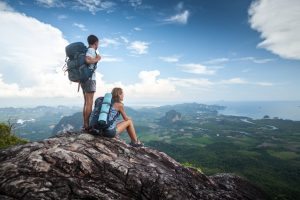 Hiker couple standing on top of the mountain