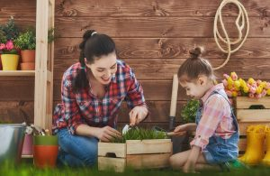 A mother and a daughter gardening together