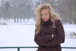 Woman standing outside in snow