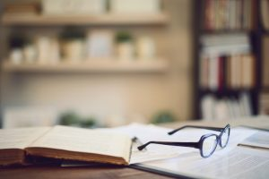 glasses and books in empty study