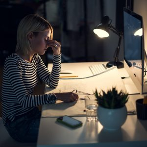 Stressed woman working at night