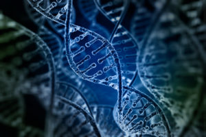 Spiral DNA strands on dark background