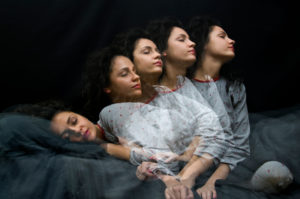 Multiple exposure photo depicts person with long curly hair rising from bed while still asleep