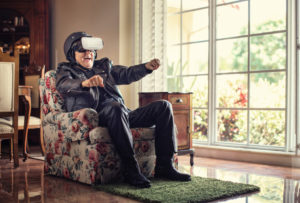 Elderly man uses VR technology to race from the comfort of his chair.