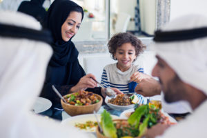 A family enjoys a lunch of salad and mezze.