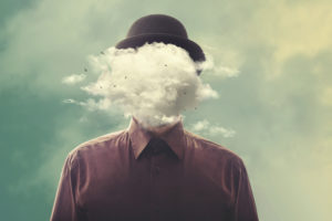 Surreal photo of person in bowler hat with cloud in place of head