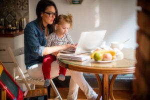 Mother with daughter working from home