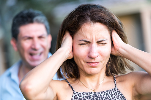 woman with misophonia covering ears