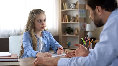 Girl talking with school counselor