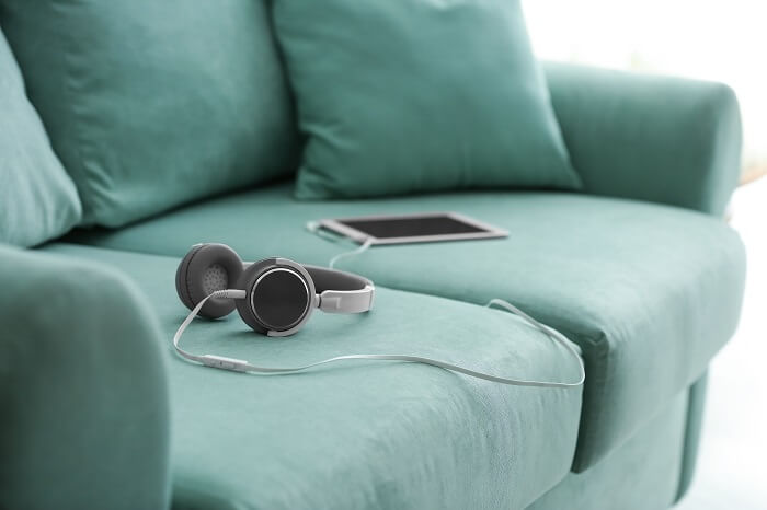 Tablet and headphones on a couch