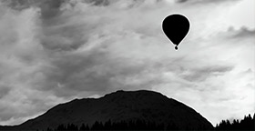 Hot air balloon over hills