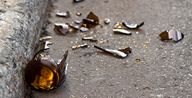 Broken beer bottle in street