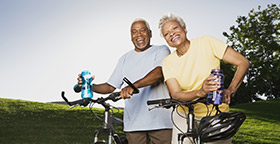 Older couple with bikes