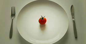 Plate with small tomato