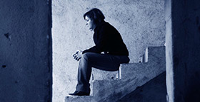 Woman sitting on cement stairs