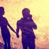 Vintage silhouette of two people holding hands