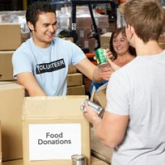 Volunteer collecting food donations