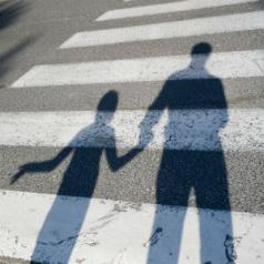 shadow of parent holding hand of child