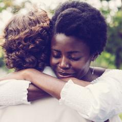 Woman hugging her friend