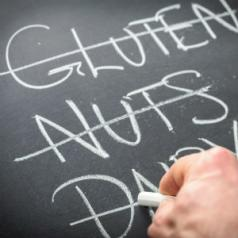 chalkboard with gluten nuts and dairy crossed off