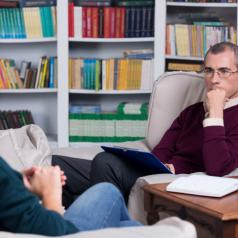 Woman in therapy session with male therapist