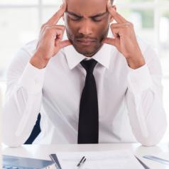 businessman meditating at desk