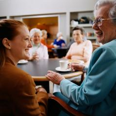 Senior in nursing home visits with family member