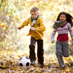 Boy and girl playing with soccer ball