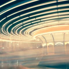 blurred image of spinning circus ride