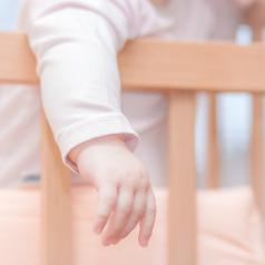 Baby standing up in a crib