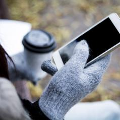 gloved hands using smartphone
