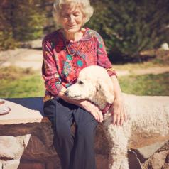 Older woman with service dog