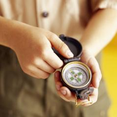 boy scout holding a compass