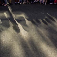 Shadows of children standing in line