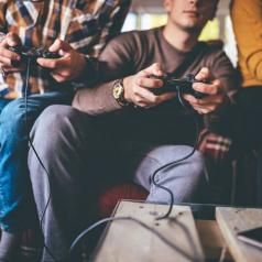 Group of friends playing video games together