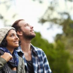 Couple stands for a moment while talking walk outside to enjoy nature