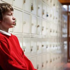 Child standing by lockers
