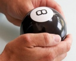 Hands are holding a magic eight-ball.