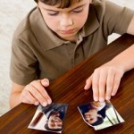 Boy with ripped photo of parents