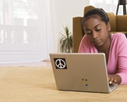 Teenage girl with laptop